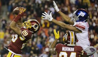 Washington Redskins cornerback Kendall Fuller (29) intercepts a pass intended for New York Giants wide receiver Travis Rudolph (19) during the second half of an NFL football game in Landover, Md., Thursday, Nov. 23, 2017. The Redskins defeated the Giants 20-10. (AP Photo/Mark Tenally)