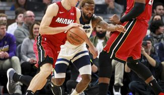 Miami Heat guard Goran Dragic (7) drives around a screen by Heat center Hassan Whiteside (21) with defense from Minnesota Timberwolves guard Aaron Brooks (30) in the first quarter of an NBA basketball game on Friday, Nov. 24, 2017, in Minneapolis. (AP Photo/Andy Clayton-King)