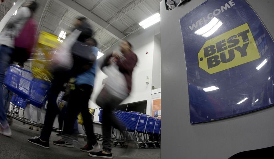 People enter a Best Buy store as it opened for a Black Friday sale on Thanksgiving Day, Thursday, Nov. 23, 2017, in Overland Park, Kan. Shoppers are hitting the stores on Thanksgiving as retailers under pressure look for ways to poach shoppers from their rivals. (AP Photo/Charlie Riedel)