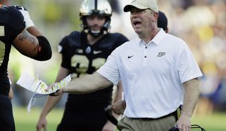 FILE - In this Sept. 23, 2017, file photo, Purdue head coach Jeff Brohm yells to an official during the first half of an NCAA college football game against Michigan in West Lafayette, Ind. Indiana and Purdue head into their regular-season finale with the same Bucket list. Indiana plays Purdue on Saturday, Nov. 25, 2017. (AP Photo/Michael Conroy, File)