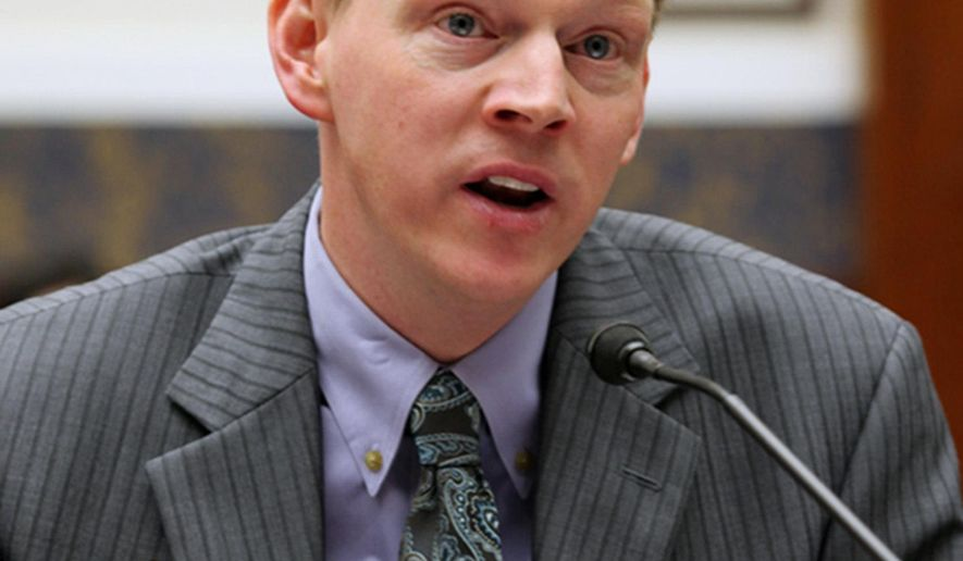 FILE- In this This October 2013 photo, Iowa Workers' Compensation Commissioner Chris Godfrey speaks in Des Moines, Iowa. Godfrey, a former state official who alleges he was pressured by then-Iowa Gov. Terry Branstad to resign because of his sexual orientation, plans to take his discrimination lawsuit to trial next year in a case closely watched by government agencies that fear it could open the door to a flood of litigation. (The Des Moines Register via AP)