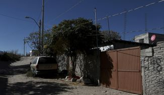 The gate stands closed at the home where three girls were attacked in a low-income neighborhood of Ciudad Juarez, Mexico, Friday, Nov. 26, 2017. A 12-year-old girl is dead after an assailant attacked her and raped her two young sisters inside this home on Wednesday, near a desert area where the bodies of numerous young women were found dumped in the 1990s. (AP Photo/Christian Torres)