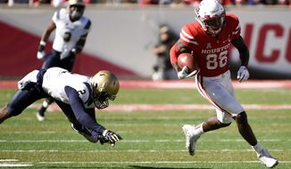 Houston wide receiver Steven Dunbar (88) escapes the tackle of Navy safety Jarid Ryan en route to a touchdown during the second half of an NCAA college football game Friday, Nov. 24, 2017, in Houston. Houston won the game 24-14. (AP Photo/Eric Christian Smith)