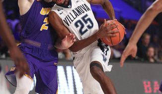 Villanova guard Mikal Bridges (25) guarded by Northern Iowa forward Klint Carlson (2) during the final day of action Nov. 24, 2017 in the Bad Boy Mowers Battle 4 Atlantis tournament in Paradise Island, Bahamas. (Tim Aylen/Bahamas Visual Services via AP)