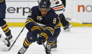 Buffalo Sabres forward Evander Kane Dives for the puck during the first period of an NHL hockey game against the Edmonton Oilers, Friday Nov. 24, 2017, in Buffalo, N.Y. (AP Photo/Jeffrey T. Barnes)