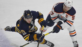 Buffalo Sabres Jack Eichel (15) and Edmonton Oilers' Conor McDavid (97) vie for the puck during the third period of an NHL hockey game, Friday Nov. 24, 2017, in Buffalo, N.Y. (AP Photo/Jeffrey T. Barnes)