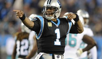 In this  Monday, Nov. 13, 2017 file photo, Carolina Panthers' Cam Newton (1) celebrates after running for a first down against the Miami Dolphins in the first half of an NFL football game in Charlotte, N.C. The Carolina Panthers are roaring into their favorite part of the season. It's the home stretch with six games, and at 7-3 with a three-game winning streak, it's no surprise the Panthers are starting to heat up. The Panthers play the New York Jets on Sunday, Nov. 26,  2017. (AP Photo/Mike McCarn, File)