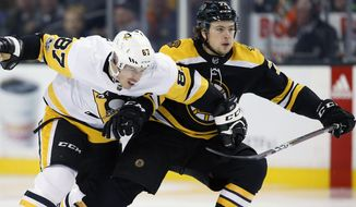 Boston Bruins' Charlie McAvoy (73) defends against Pittsburgh Penguins' Sidney Crosby (87) during the first period of an NHL hockey game in Boston, Friday, Nov. 24, 2017. (AP Photo/Michael Dwyer)