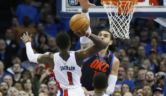 Detroit Pistons guard Reggie Jackson, left, is fouled by Oklahoma City Thunder center Steven Adams, right, as he shoots in the fourth quarter of an NBA basketball game in Oklahoma City, Friday, Nov. 24, 2017. Detroit won 99-98. (AP Photo/Sue Ogrocki)