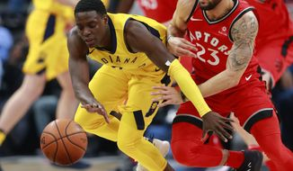 Indiana Pacers guard Darren Collison, left, and Toronto Raptors guard Fred VanVleet (23) chase the ball during the first half of an NBA basketball game, Friday, Nov. 24, 2017, in Indianapolis. Indiana won 107-104. (AP Photo/R Brent Smith)