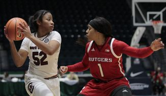 South Carolina's Tyasha Harris (52) is covered by Rutgers' Jazlynd Rollins (1) during the second half an NCAA college basketball game in the Gulf Coast Showcase basketball tournament Friday, Nov. 24, 2017, in Estero, Fla. (AP Photo/Luis M. Alvarez)