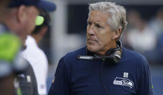 FILE - In this Oct. 29, 2017, file photo, Seattle Seahawks head coach Pete Carroll stands on the sideline during an NFL football game against the Houston Texans in Seattle. Carroll and the Seahawks have a lot bigger worries than wondering if the San Francisco 49ers are ready to make a quarterback switch to Jimmy Garoppolo. (AP Photo/Elaine Thompson, File)