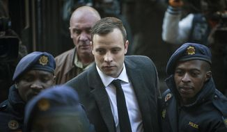 In this July 6, 2016, file photo, Oscar Pistorius, center, arrives at the High Court in Pretoria, South Africa, for a sentencing hearing for the murder of his girlfriend Reeva Steenkamp in his home on Valentine's Day 2013. Pistorius has had his prison sentence extended to 13 years and 5 months in the High Court of Appeal in Bloemfontein Friday, Nov. 24, 2017. (AP Photo/Shiraaz Mohamed, File)