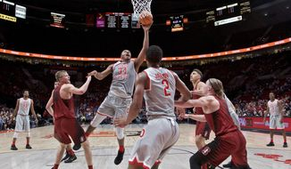 Ohio State forward Kaleb Wesson, center, shoots against Stanford during the first half of an NCAA college basketball game in the Phil Knight Invitational tournament in Portland, Ore., Friday, Nov. 24, 2017. (AP Photo/Craig Mitchelldyer)