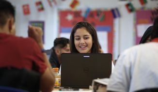 Zayra Granados, 17, from El Salvador, works with the civics computer game iCivics during Phoebe Sherman's 11th grade social studies class at Roosevelt High School's International Academy in Washington, Thursday, Nov. 16, 2017. Supreme Court Justice Sonia Sotomayor and former Supreme Court Justice Sandra Day O'Connor are backing iCivics that is now being translated into Spanish. (AP Photo/Carolyn Kaster)