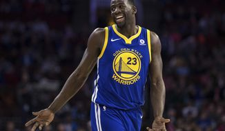 """In this Nov. 18, 2017, photo, Golden State Warriors' Draymond Green reacts during the second half of an NBA basketball game against the Philadelphia 76ers in Philadelphia. Green and Kevin Durant bet on just about anything. """"Life,"""" Green explained, """"who drives home faster from the practice facility, who gets to the game earlier. You want us to tell you our whole life?"""" KD and Dray have formed quite a bond since way back, when Green was part of the strategic recruiting process to bring Durant to the Bay Area from Oklahoma City before last season. (AP Photo/Chris Szagola, File)"""