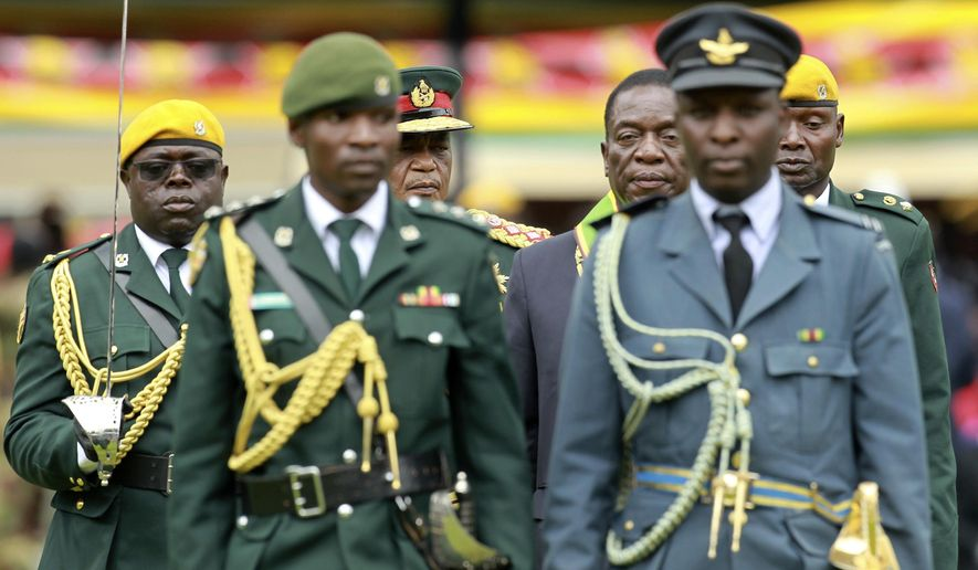 Emmerson Mnangagwa (center right) with army Gen. Constantino Chiwenga, inspected the military parade after being sworn in as Zimbabwe's president on Nov. 24. The military's stunning and prominent role in overthrowing Robert Mugabe and the way the bloodless coup was conducted have raised questions about whether the troops will return to their barracks so readily. (Associated Press/File)