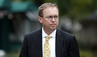 White House Budget Director Mick Mulvaney is in a battle to be temporary director of the Consumer Financial Protection Bureau. President Trump named him within a few hours after outgoing director Richard Cordray made a move Friday to seat his own deputy. (Associated Press/File)