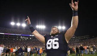 Auburn tight end Tucker Brown celebrates after the Iron Bowl NCAA college football game, Saturday, Nov. 25, 2017, in Auburn, Ala. Auburn won 26-14. (AP Photo/Brynn Anderson)