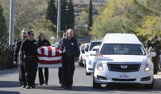 Pallbearers carry Border Patrol agent Rogelio Martinez into Our Lady of Guadalupe Church for a funeral Mass, Saturday, Nov. 25, 2017 in El Paso, Texas. (Mark Lambie/The El Paso Times via AP)