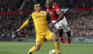 Brighton & Hove Albion's Anthony Knockaert, left, and Manchester United's Ashley Young clash during the English Premier League soccer match at Old Trafford in Manchester, England, Saturday Nov. 25, 2017. (Martin Rickett/PA via AP)