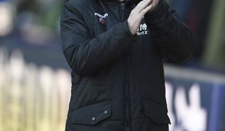 Crystal Palace manager Roy Hodgson reacts during during the match against Stoke City, during their English Premier League soccer match at Selhurst Park in London, Saturday Nov. 25, 2017. (Daniel Hambury/PA via AP)
