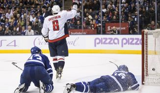 Washington Capitals' Alex Ovechkin celebrates his goal as Toronto Maple Leafs' Nazem Kadri and Mitchell Marner, right, are on the ice during the third period of an NHL hockey game in Toronto on Saturday, Nov. 25, 2017. (Chris Young/The Canadian Press via AP)