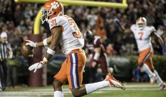 Clemson cornerback Ryan Carter (31) scores a touchdown after intercepting a pass against South Carolina during the first half of an NCAA college football game Saturday, Nov. 25, 2017, in Columbia, S.C. (AP Photo/Sean Rayford)