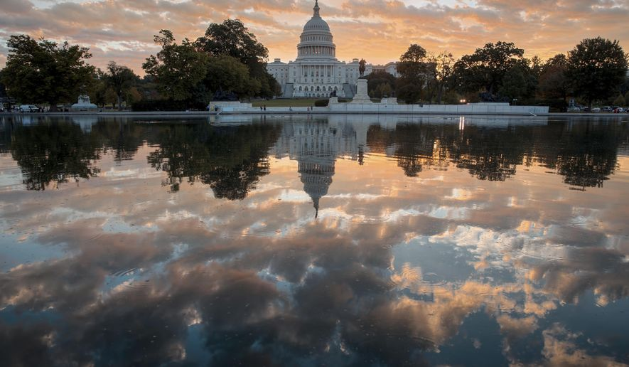 FILE - In this Oct. 10, 2017, file photo, the Capitol is seen at sunrise, in Washington. The crush of unfinished business facing lawmakers when they return to the Capitol this week would be daunting even if Washington were functioning at peak efficiency. (AP Photo/J. Scott Applewhite, File)
