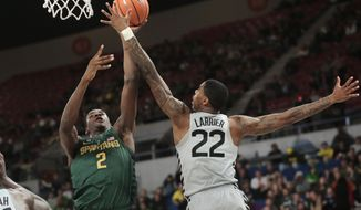 Michigan State's Jaren Jackson (2) shoots over Connecticut's Terry Larrier (22) during the first half of an NCAA college basketball game during the Phil Knight Invitational tournament in Portland, Ore., Friday, Nov. 24, 2017. (AP Photo/Timothy J. Gonzalez)