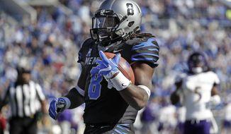 Memphis running back Darrell Henderson (8) scores a touchdown on a 14-yard run against East Carolina in the first half of an NCAA college football game, Saturday, Nov. 25, 2017, in Memphis, Tenn. (AP Photo/Mark Humphrey)