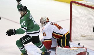 Dallas Stars right wing Alexander Radulov (47) celebrates his goal against Calgary Flames goalie Mike Smith (41) during the second period of an NHL hockey game in Dallas, Friday, Nov. 24, 2017. (AP Photo/LM Otero)