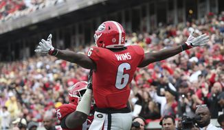 Georgia wide receiver Javon Wims (6) celebrates his touchdown against Georgia Tech during the first half of an NCAA college football game, Saturday, Nov. 25, 2017, in Atlanta. (AP Photo/John Bazemore)