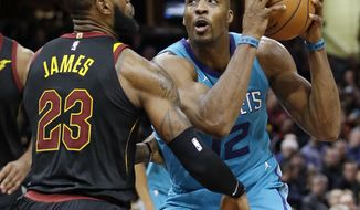 Charlotte Hornets' Dwight Howard (12) drives against Cleveland Cavaliers' LeBron James (23) in the second half of an NBA basketball game, Friday, Nov. 24, 2017, in Cleveland. (AP Photo/Tony Dejak)