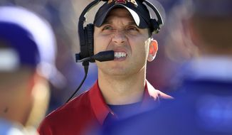 Iowa State head coach Matt Campbell looks at the scoreboard during the first half of an NCAA college football game against Kansas State in Manhattan, Kan., Saturday, Nov. 25, 2017. (AP Photo/Orlin Wagner)
