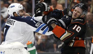 Winnipeg Jets defenseman Ben Chiarot (7) tangles with Anaheim Ducks right wing Corey Perry (10) during the second period of an NHL hockey game in Anaheim, Calif., Friday, Nov. 24, 2017. (AP Photo/Alex Gallardo)