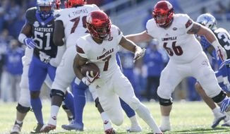 Louisville running back Reggie Bonnafon runs for a touchdown during the first half of an NCAA college football game against Kentucky, Saturday, Nov. 25, 2017, in Lexington, Ky. (AP Photo/David Stephenson)