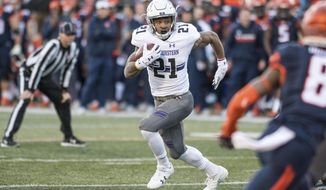 Northwestern running back Justin Jackson (21) runs the ball during the first quarter of an NCAA college football game against Illinois Saturday, Nov. 25, 2017 at Memorial Stadium in Champaign, Ill. (AP Photo/Bradley Leeb)