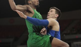 Oregon's Troy Brown, left, tries to drive the lane while guarded by DePaul's Marin Maric, right, in the second half of an NCAA college basketball game during the Phil Knight Invitational tournament in Portland, Ore., Friday, Nov. 24, 2017. (AP Photo/Timothy J. Gonzalez)