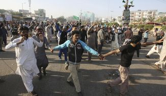 Supporters of religious groups rally to express solidarity with protesters block main highway in capital, Saturday, Nov. 25, 2017. Pakistani police have launched an operation to clear an intersection linking capital Islamabad with the garrison city of Rawalpindi where an Islamist group's supporters have camped out for the last 20 days. (AP Photo/Fareed Khan)