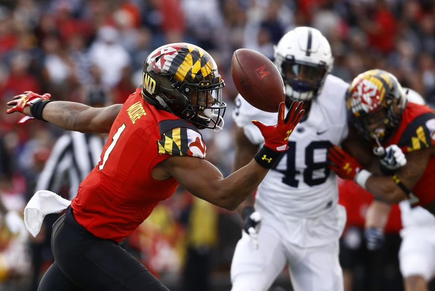 Maryland wide receiver D.J. Moore, left, bobbles a pass attempt as he is pressured by Penn State defensive end Shareef Miller (48) in the first half of an NCAA college football game in College Park, Md., Saturday, Nov. 25, 2017. (AP Photo/Patrick Semansky)