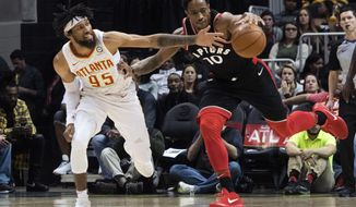 Atlanta Hawks forward DeAndre' Bembry (95) and Toronto Raptors guard DeMar DeRozan (10) vie for the ball during the first half of a NBA basketball game, Saturday, Nov. 25, 2017, in Atlanta. (AP Photo/John Amis)