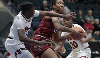 South Carolina's A'ja Wilson, center, prepares to shoot against St. John's Alisha Kebbe, left, and Akina Wellere (20) during the first quarter of the Gulf Coast Showcase NCAA college basketball tournament, Saturday, Nov. 25, 2017, in Estero, Fla. (AP Photo/Luis M. Alvarez)