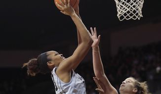 Connecticut's Azura Stevens, center, shoots over Michigan State's Jenna Allen, right, in the second half of an NCAA college basketball game during the Phil Knight Invitational tournament in Eugene, Ore., Saturday, Nov. 25, 2017. (AP Photo/Timothy J. Gonzalez)