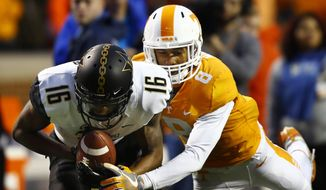 Vanderbilt wide receiver Kalija Lipscomb (16) makes a catch as he's defended by Tennessee defensive back Justin Martin (8) in the first half of an NCAA college football game Saturday, Nov. 25, 2017, in Knoxville, Tenn. (AP Photo/Wade Payne)