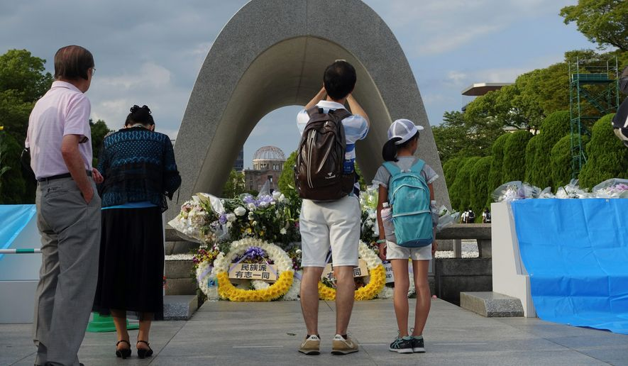 "With an appeal of ""never again,"" Japanese visited Peace Memorial Park in Hiroshima this year to mark the 72nd anniversary of the 1945 attack that killed 140,000 people. (Associated Press/File)"