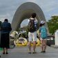 """With an appeal of """"never again,"""" Japanese visited Peace Memorial Park in Hiroshima this year to mark the 72nd anniversary of the 1945 attack that killed 140,000 people. (Associated Press/File)"""