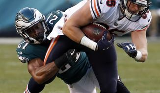 Chicago Bears' Daniel Brown (85) is tackled by Philadelphia Eagles' Patrick Robinson (21) during the second half of an NFL football game, Sunday, Nov. 26, 2017, in Philadelphia. (AP Photo/Chris Szagola)