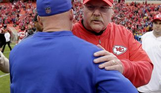 Kansas City Chiefs head coach Andy Reid, front right, and Buffalo Bills head coach Sean McDermott shake hands after their NFL football game Sunday, Nov. 26, 2017, in Kansas City, Mo. (AP Photo/Charlie Riedel)