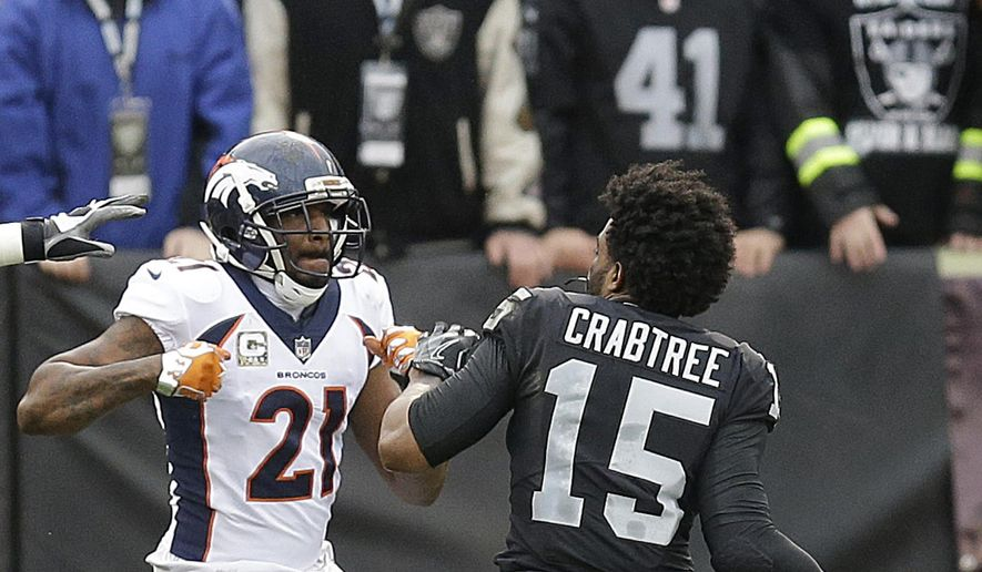Denver Broncos cornerback Aqib Talib (21) fights Oakland Raiders wide receiver Michael Crabtree (15) during the first half of an NFL football game in Oakland, Calif., Sunday, Nov. 26, 2017. (AP Photo/Ben Margot) **FILE**